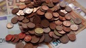 cent : Many coins and bills, euros, money Stock Footage