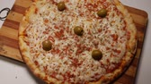 ser : Italian Pizza, olives and condiments