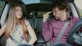 convince : Father trying to teach lesson to daughter while driving car Stock Footage
