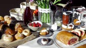 джем : Pan on italian pastry and croissant for breakfast on hotel table dolly shot