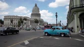 stary : Blue old cuban car crosses the street near the Capitol of La havana Cuba