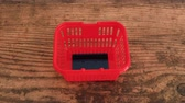 giderler : shopping and marketing concept, credit card thrown into empty red shopping basket Stok Video