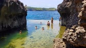 indonesia : BALI, INDONESIA - MARCH 24, 2018: Footage of tourist at billabong beach , Nusa Penida, Indonesia