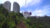 molas : GENTING HIGHLAND, MALAYSIA - SEPTEMBER 16, 2017: The cable car ride, one of Genting Highlands most popular attractions, providing a method of travel between Awana Station and SkyAvenue mall