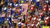 prize : KUALA LUMPUR, MALAYSIA, AUGUST 29, 2017 - Malaysian supporter chanting while holding flag during 29th Sea Games Kuala Lumpur 2017.