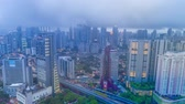 Time-lapse of a Kuala Lumpur city skyline during cloudy day with busy light trails in Malaysia
