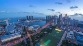 Sunset day to night scene at Singapore Marina Bay city skyline. Stock Footage