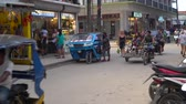 risciò : EL NIDO, PHILIPPINE - Busy Street at El Nido with a lot of Tuk-tuk tricycle and tourist passyby
