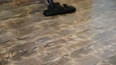 ламинат : Brush vacuum cleaner walks the floor, removes dirt and dust. slowmotion. 1920x1080