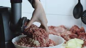 mincer : Close-up beef and pork meat and onion through electric meat mincer at home.