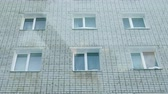 аренда : Six white windows of a brick house. Outside view of the building.