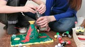 pipeta : Chemical experiment. Close-up of the boys hands poured water from the bottle into the funnel of the volcano using a pipette.