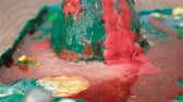 intently : Closeup view of chemical reaction with gas emission. Experience with plasticine volcano at home. Stock Footage