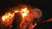 поход : Food is cooked on the bonfire in a pot. Close-up top view.