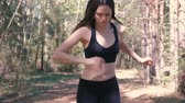 joggers : Woman in sportswear is Jogging in the Park. Slow motion.