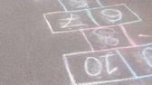hop garden : Hopscotch game on asphalt in Park. Painted with colorful chalks.