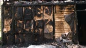 romos : Burned down private wooden house.