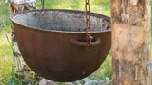 outing : Cauldron, pot for cooking hanging on chains over the fire.