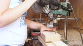 Worker drills holes in wooden templates. Manufacture of wooden toys. Close-up hands. Stok Video