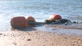 буй : Buoys in the waves on the sand on the coast.