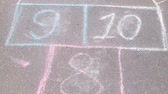 three two one : Hopscotch game on asphalt in Park. Painted with colorful chalks.