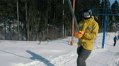 сноуборд : Snowboarders on the ski lift to the mountain.