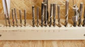 drills : Drills of different sizes in the workshop. Set of drill bits stand in a row.