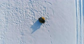 śnieżka : Boy of 7 years is laying on tubing in the snow. Camera slowly rising and spinning. Aerial footage.