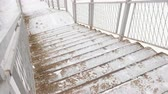 deslize : Staircase covered in snow in winter day.
