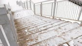 滑りやすい : Staircase covered in snow in winter day. Toop view.