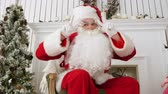 imagens : Santa Claus showing a victory sign with both hands Stock Footage