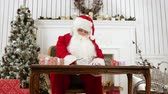 Санта шляпе : Santa answering letters in his workshop and explaining what its like to be Santa