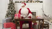 suddenness : Santa Claus checking his list of presents