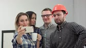 foreman : Happy young architects taking funny selfies in office Stock Footage