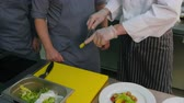 citrus fruit dish : Chef showing his assistants how to choose oranges for seafood appetizer on a white plate