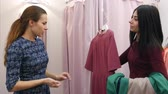 pokukování : Beautiful young woman trying on new dress, but does not like it and choosing a new one
