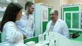eczacı : Positive team of pharmacist talking and smiling at the hospital pharmacy Stok Video