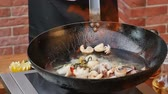 vieira : Cooking and mixing seafood in the pan Stock Footage