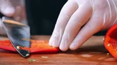 cucumber pieces : utting red pepper on wooden table