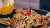 rice pan : Finishing paella, decorating it with lemon