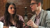 destructive : Beautiful couple smokes hookah and talk in the bar Stock Footage