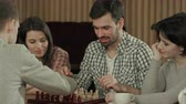 kara tahta : Friends spending time playing chess Stok Video