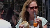 judaico : Young tourist girl eating street food at the city market