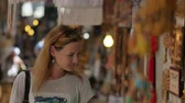 thrift : Young female tourist exploring Old Market Stock Footage