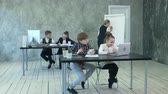 калькулятор : Little business kids having busy day in office Стоковые видеозаписи