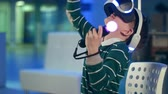 videogame screen : Active little boy enjoying virtual reality with motion controllers in his hands