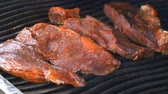 snacks : UHD shot of the delicious seasoned beef on the grill Stock Footage