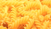 makaróny : UHD macro of the dry Fusilli pasta on a rotating stand