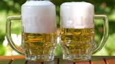 pinta : Outdoor UHD closeup shot of two glasses of lager beer