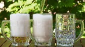 pivo : Outdoor UHD closeup shot of three glasses of lager beer